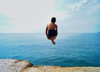 time lapse photography of boy in black shorts jumping on 1655822